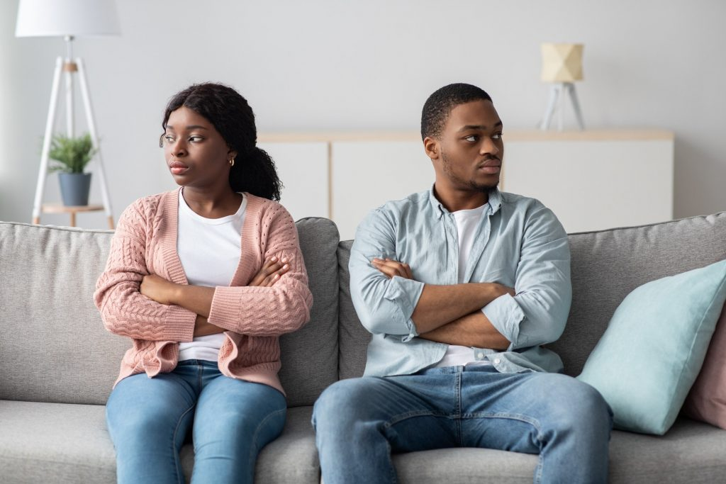 Disappointed african american couple having relationships crisis